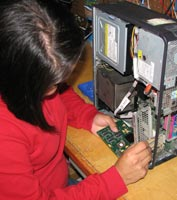 Technician working on desktop computer